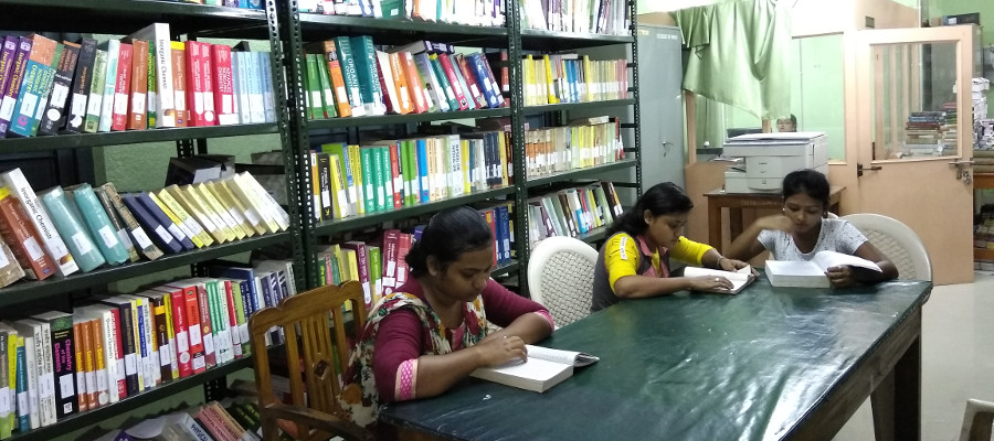 a photo of girls studying at the library